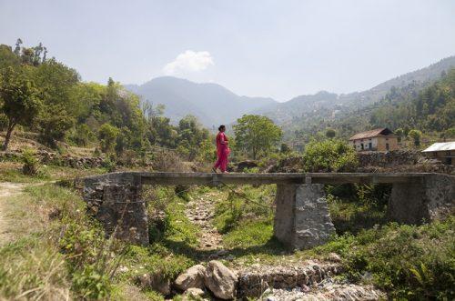 Women walking on a bridge in Nepal countryside.